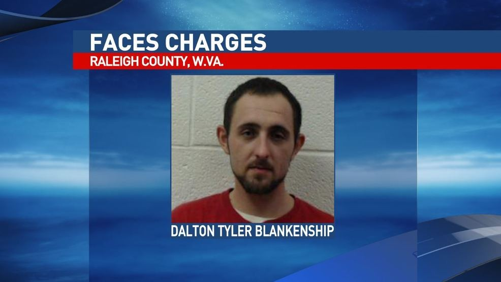 Records: Raleigh County man charged after setting home on