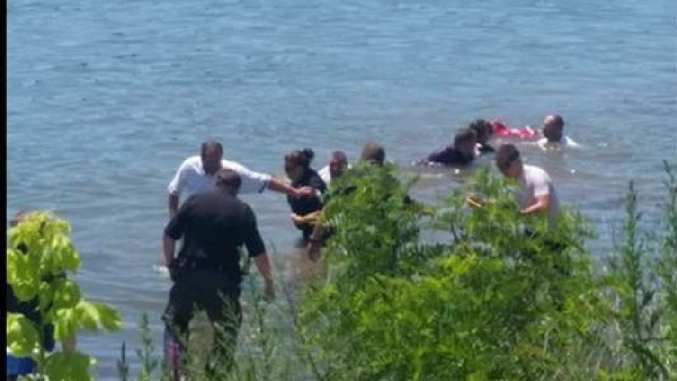Sheriff, police officers rescue man from river in Lawrence