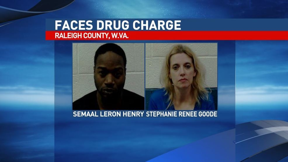Four charged in Beckley after heroin, cash, guns seized from search